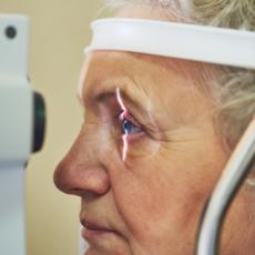 Image of elderly woman having her eyes examined.