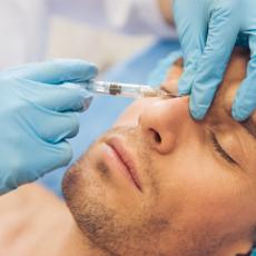 Image of Attractive Man Getting Injection Near Eyes.